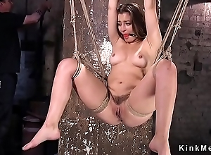 Hogtied brunette receives pussy rubbed